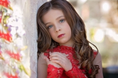 child-close-up-photography-styled-red-dress