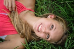 Senior-Portrait-Lying-In-Grass